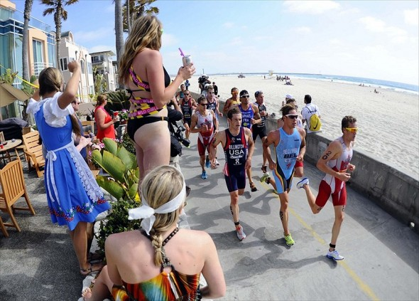 May 12, 2012; San Diego, CA, USA; A group of runners led by Kyle Jones (CAN) and Simon De Cuy per (BEL) run past fans along the beach in the mens elite race of the ITU World Championship Series at Mission Bay Park. Mandatory Credit: Christopher Hanewinckel-USA TODAY Sports