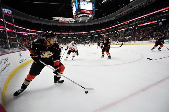 March 8, 2013; Anaheim, CA, USA; Anaheim Ducks right wing Emerson Etem (65) controls the puck against the Calgary Flames during the third period at Honda Center. Mandatory Credit: Gary A. Vasquez-USA TODAY Sports