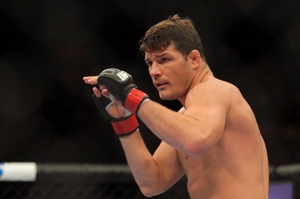 Apr 27, 2013; Newark, NJ, USA; Michael Bisping (red gloves) competes against Alan Belcher (not pictured) during UFC 159 at the Prudential Center. Mandatory Credit: Brad Penner-USA TODAY Sports