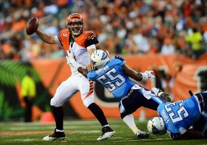 Aug 17, 2013; Cincinnati, OH, USA; Cincinnati Bengals quarterback John Skelton (9) is pressed in the backfield by Tennessee Titans outside linebacker Zach Brown (55) in the second quarter of a preseason game at Paul Brown Stadium. Mandatory Credit: Andrew Weber-USA TODAY Sports