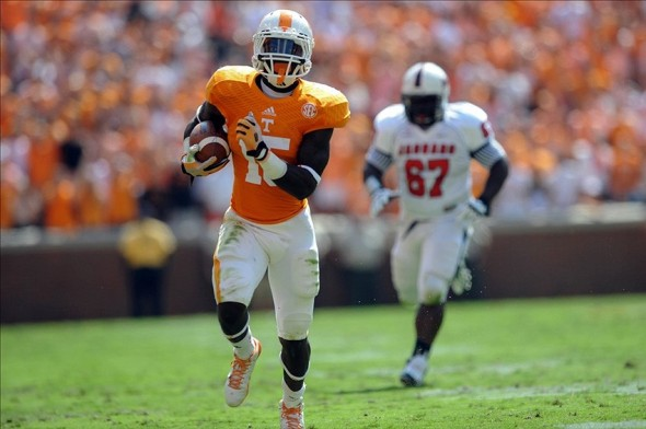Sep 28, 2013; Knoxville, TN, USA; Tennessee Volunteers running back Marlin Lane (15) runs the ball against the South Alabama Jaguars during the first quarter at Neyland Stadium. Mandatory Credit: Randy Sartin-USA TODAY Sports