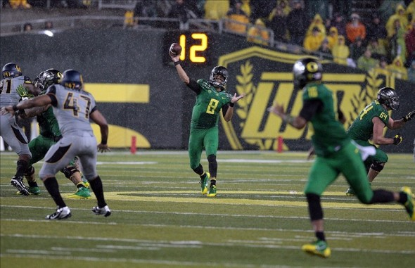 Sep 28, 2013; Eugene, OR, USA; Oregon Ducks quarterback Marcus Mariota (8) throws a pass to Oregon Ducks wide receiver Daryle Hawkins (16) against the California Golden Bears at Autzen Stadium. Mandatory Credit: Scott Olmos-USA TODAY Sports