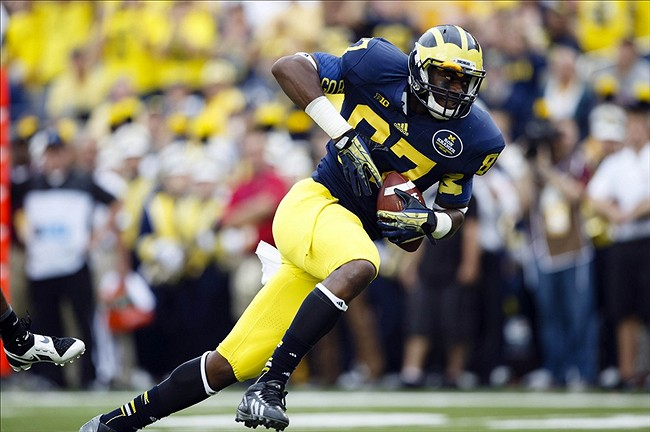 Oct 5, 2013; Ann Arbor, MI, USA; Michigan Wolverines tight end Devin Funchess (87) scores a touchdown in the second quarter against the Minnesota Golden Gophers at Michigan Stadium. Mandatory Credit: Rick Osentoski-USA TODAY Sports