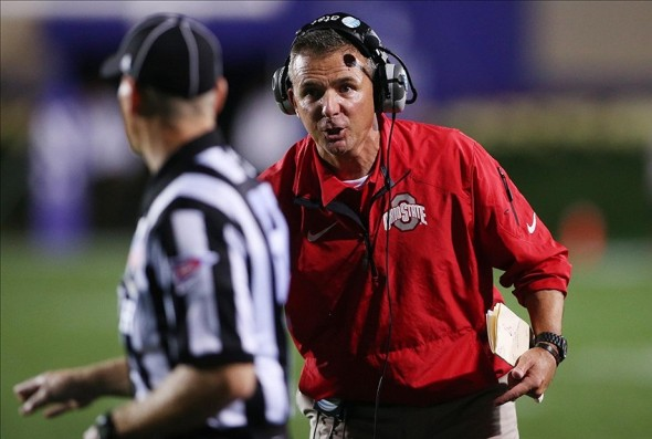 Oct 5, 2013; Evanston, IL, USA; Ohio State Buckeyes head coach Urban Meyer (right) yells at an official during the fourth quarter against the Northwestern Wildcats at Ryan Field. Ohio State won 40-30. Mandatory Credit: Jerry Lai-USA TODAY Sports