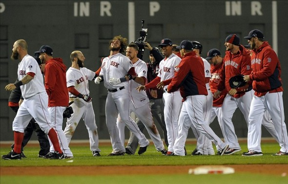 Oct 13, 2013; Boston, MA, USA; The Boston Red Sox celebrate after game two of the American League Championship Series baseball game against the Detroit Tigers at Fenway Park. Mandatory Credit: Bob DeChiara-USA TODAY Sports