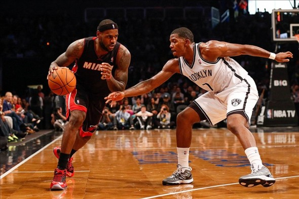 Oct 17, 2013; Brooklyn, NY, USA; Miami Heat small forward LeBron James (6) drives around Brooklyn Nets shooting guard Joe Johnson (7) during the first quarter at Barclays Center. Mandatory Credit: Anthony Gruppuso-USA TODAY Sports