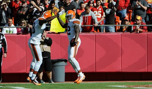 Oct 27, 2013; Kansas City, MO, USA; Cleveland Browns wide receiver Josh Gordon (12) celebrates with wide receiver Greg Little (18) after scoring a touchdown against Kansas City Chiefs in the first half at Arrowhead Stadium. Mandatory Credit: John Rieger-USA TODAY Sports