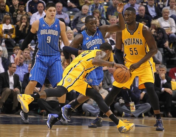 Oct 29, 2013; Indianapolis, IN, USA; Indiana Pacers forward Paul George (24) drives to the basket against Orlando Magic guard Victor Oladipo (5) at Bankers Life Fieldhouse. Mandatory Credit: Brian Spurlock-USA TODAY Sports