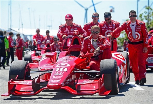 Jul 13, 2013; Toronto, ON, Canada; Crew members of IndyCar Series driver Dario Franchitti push the car onto the grid prior to the start of the Honda Indy Toronto through the streets of downtown Toronto. Mandatory Credit: Andrew Weber-USA TODAY Sports
