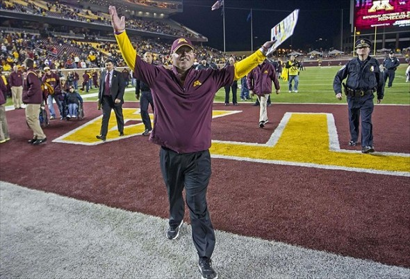 Sept 22, 2012; Minneapolis, MN, USA: Minnesota Golden Gophers head coach Jerry Kill waves his arms up and down to the crowd after beating the Syracuse Orange at TCF Bank Stadium. The Gophers won 17-10. Mandatory Credit: Jesse Johnson-USA TODAY Sports