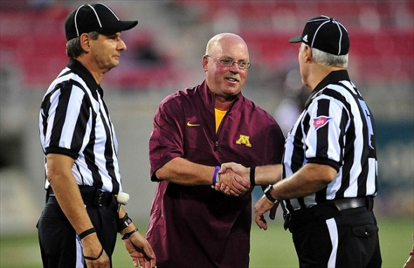August 30, 2012; Las Vegas, NV, USA; Minnesota Golden Gophers head coach Jerry Kill greets officlals before Minnesota plays against the UNLV Rebels at Sam Boyd Stadium. Mandatory Credit: Gary A. Vasquez-USA TODAY Sports