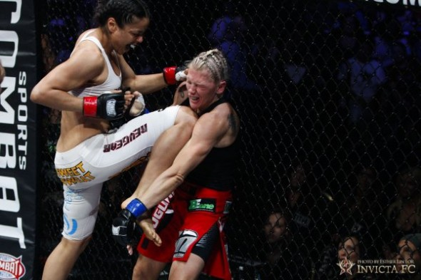 Miriam Nakamoto lands a knee on Duda Yankovich. Photo Credit: Esther Lin - Invicta FC