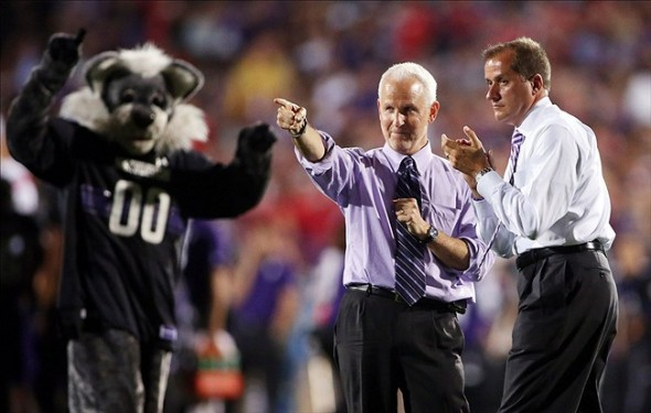Oct 5, 2013; Evanston, IL, USA; Northwestern Wildcats university president Morton Shapiro (middle) and athletic director Jim Phillips on the field during the second quarter against the Ohio State Buckeyes at Ryan Field. Mandatory Credit: Jerry Lai-USA TODAY Sports