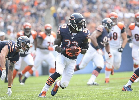Sep 8, 2013; Chicago, IL, USA; Chicago Bears cornerback Charles Tillman (33) makes an interception during the second quarter at Soldier Field. Mandatory Credit: Mike DiNovo-USA TODAY Sports