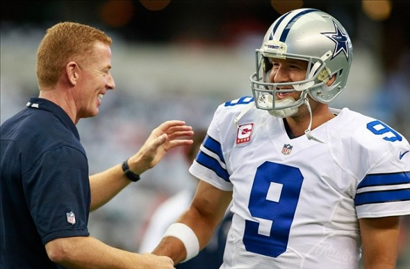Oct 6, 2013; Arlington, TX, USA; Dallas Cowboys head coach Jason Garrett talks to quarterback Tony Romo (9) before the game against the Denver Broncos at AT
