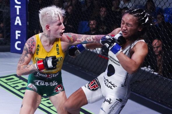 Bec Hyatt delievers a shot to Carla Esparza at Invict FC 4. Hyatt is one of the athletes participating in the MZ and Emmers Sports Bra Auction Female Fighters Unite event. Photo Credit: Esther Lin-Invicta FC