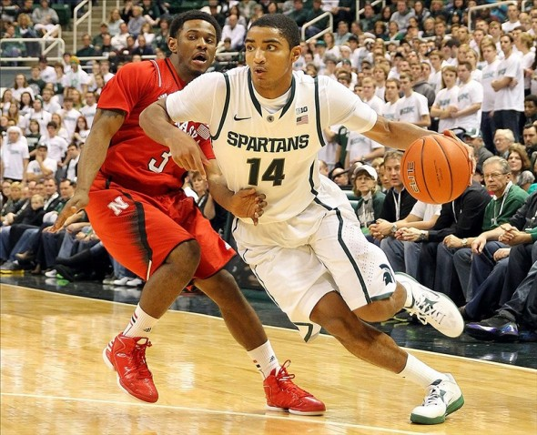 Jan. 13, 2013; East Lansing, MI, USA; Michigan State Spartans guard Gary Harris (14) drives to the basket against Nebraska Cornhuskers guard Benny Parker (3) during 2nd half at Jack Breslin Students Events Center. MSU won 66-56. Mandatory Credit: Mike Carter-USA TODAY Sports