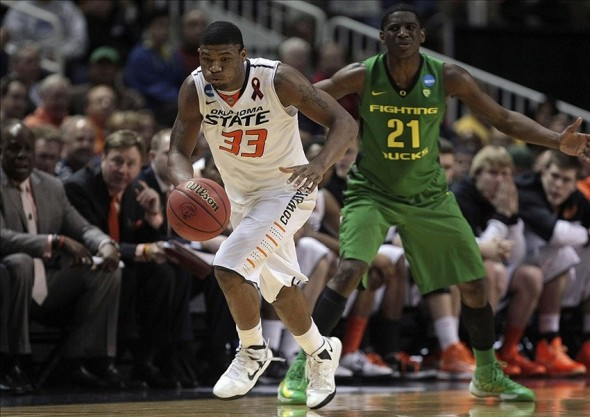 Mar 21, 2013; San Jose, CA, USA; Oklahoma State Cowboys guard Marcus Smart (33) on a fast break ahead of Oregon Ducks guard Damyean Dotson (21) during the first half of the second round of the 2013 NCAA tournament at HP Pavilion. Mandatory Credit: Kelley L Cox-USA TODAY Sports