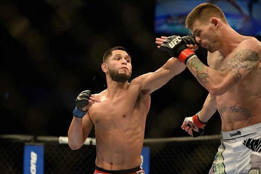 Apr 20, 2013; San Jose, CA, USA; Tim Means (right) fights Jorge Masvidal (left) during the lightweight bout prelims of the UFC on Fuel TV at HP Pavilion. Mandatory Credit: Kyle Terada-USA TODAY Sports