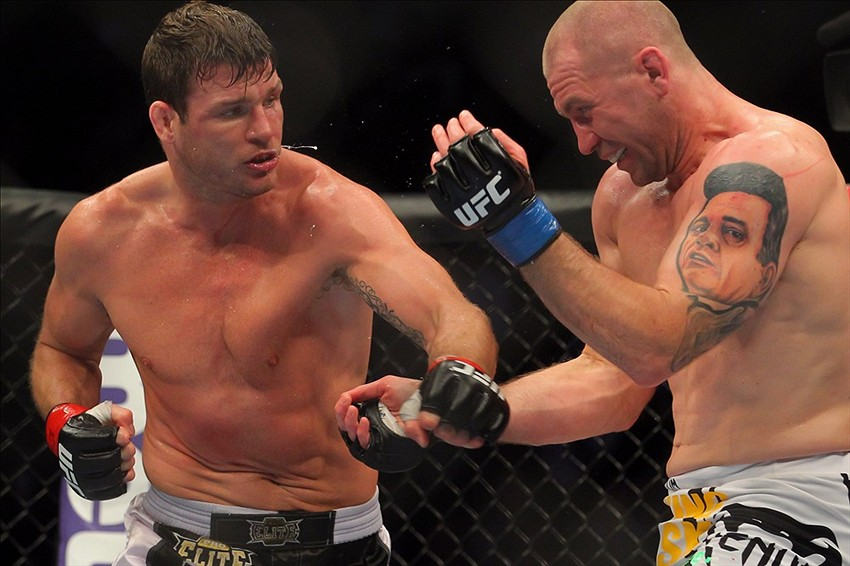Apr 27, 2013; Newark, NJ, USA; Michael Bisping (red gloves) competes against Alan Belcher (blue gloves) during UFC 159 at the Prudential Center. Mandatory Credit: Brad Penner-USA TODAY Sports