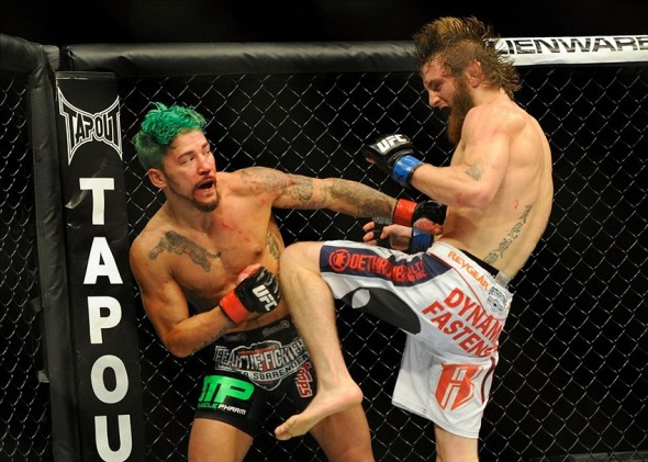 Aug 31, 2013; Milwaukee, WI, USA; Louis Gaudinot (left) fights Tim Elliott during the UFC-164 bout at BMO Harris Bradley Center. Mandatory Credit: Benny Sieu-USA TODAY Sports