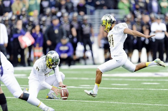 Oct 12, 2013; Seattle, WA, USA; Oregon Ducks kicker Alejandro Maldonado (41) kicks and makes the extra point against the Washington Huskies during the 1st half at Husky Stadium. Mandatory Credit: Steven Bisig-USA TODAY Sports