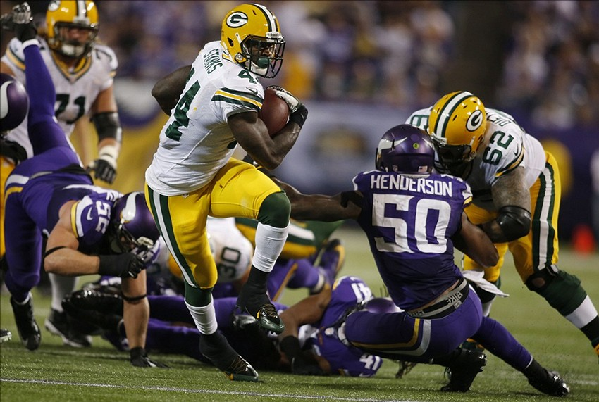 Oct 27, 2013; Minneapolis, MN, USA; Green Bay Packers running back James Starks (44) rushes for a touchdown against the Minnesota Vikings in the fourth quarter at Mall of America Field at H.H.H. Metrodome. Mandatory Credit: Bruce Kluckhohn-USA TODAY Sports