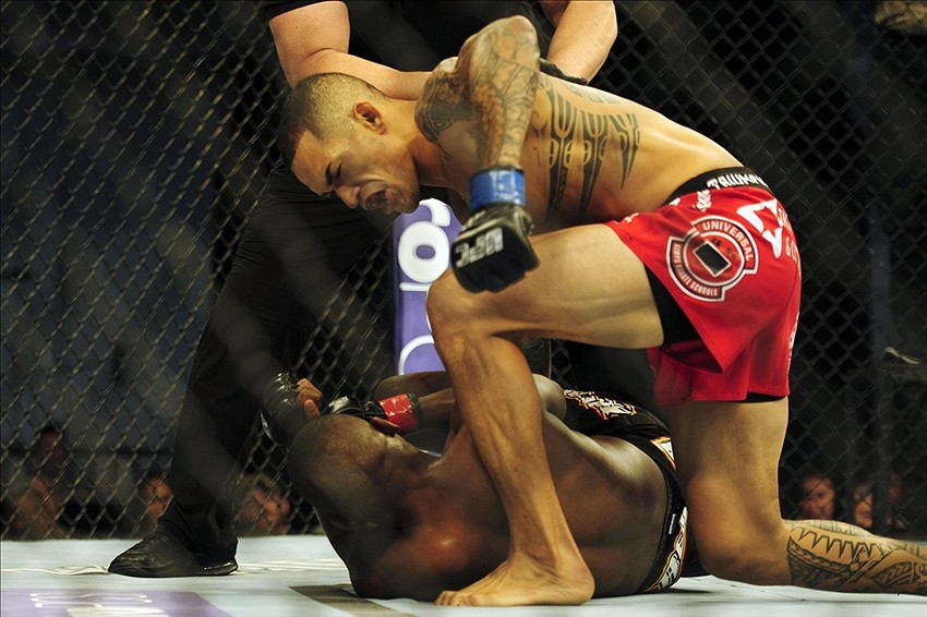 Nov 6, 2013; Fort Campbell, KY, USA; Yves Edwards (red gloves) fights Yancy Medeiros (blue gloves) in the lightweight bout during UFC Fight for the Troops at Fort Campbell. Mandatory Credit: Joshua Lindsey-USA TODAY Sports