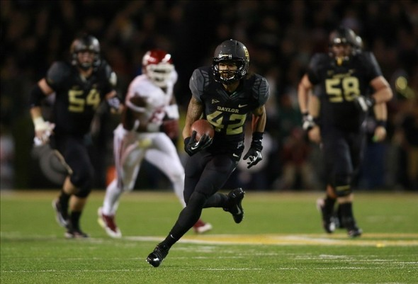 Nov 7, 2013; Waco, TX, USA; Baylor Bears wide receiver Levi Norwood (42) runs with the ball after making a catch against the Oklahoma Sooners at Floyd Casey Stadium. Mandatory Credit: Tim Heitman-USA TODAY Sports