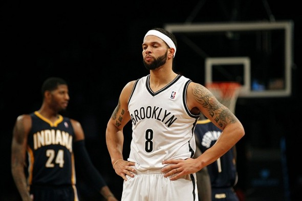 Nov 9, 2013; Brooklyn, NY, USA; Brooklyn Nets point guard Deron Williams (8) reacts in the second half against the Indiana Pacers at Barclays Center. Mandatory Credit: Noah K. Murray-USA TODAY Sports