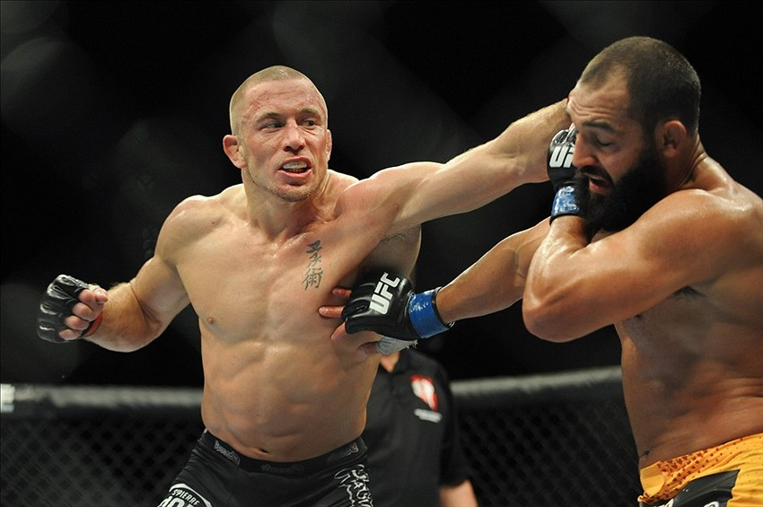 Nov 16, 2013; Las Vegas, NV, USA; Georges St-Pierre (red gloves) fights against Johny Hendricks (blue gloves) in their welterweight championship bout during UFC 167 at MGM Grand Garden Arena. Mandatory Credit: Stephen R. Sylvanie-USA TODAY Sports