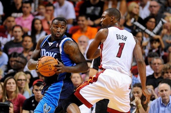 Nov 15, 2013; Miami, FL, USA; Dallas Mavericks center DeJuan Blair (45) is pressured by Miami Heat center Chris Bosh (1) during the second half at American Airlines Arena. Miami won 110-104. Mandatory Credit: Steve Mitchell-USA TODAY Sports