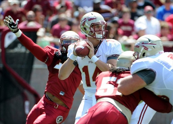 April 13, 2013; Tallahassee, FL, USA; Florida State Seminoles quarterback Jacob Coker (14) is pressured during the first half of the spring game at Doak Campbell Stadium. Mandatory Credit: Melina Vastola-USA TODAY Sports