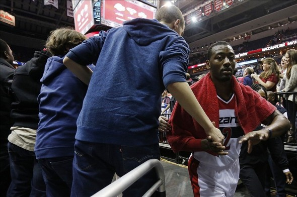 Nov 23, 2013; Washington, DC, USA; Washington Wizards point guard John Wall (2) shakes hands with fans after the Wizards game against the New York Knicks at Verizon Center. The Wizards won 98-89. Mandatory Credit: Geoff Burke-USA TODAY Sports