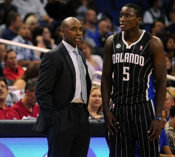 Nov 8, 2013; Orlando, FL, USA; Orlando Magic head coach Jacque Vaughn talks with shooting guard Victor Oladipo (5) during a timeout as the Boston Celtics beat the Orlando Magic 91-89 at Amway Center. Mandatory Credit: David Manning-USA TODAY Sports