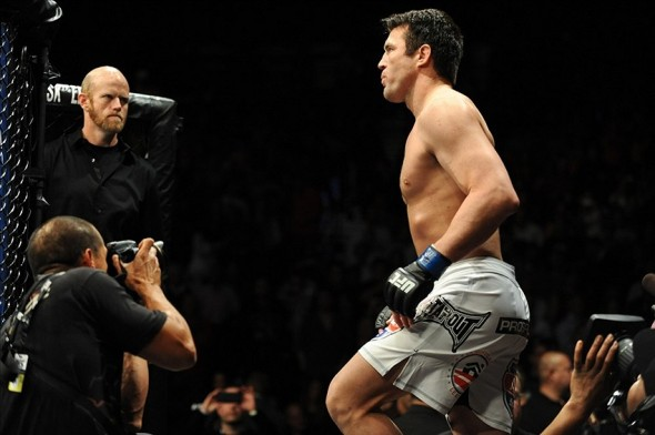 Nov 16, 2013; Las Vegas, NV, USA; Chael Sonnen (blue gloves) walks towards the cage before his light heavyweight bout during UFC 167 at MGM Grand Garden Arena. Mandatory Credit: Stephen R. Sylvanie-USA TODAY Sports