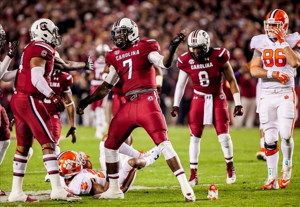 Nov 30, 2013; Columbia, SC, USA; South Carolina Gamecocks defensive end Jadeveon Clowney (7) celebrates a tackle for loss against the Clemson Tigers in the second quarter at Williams-Brice Stadium. Mandatory Credit: Jeff Blake-USA TODAY Sports