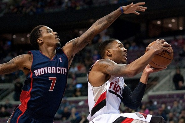 Dec 15, 2013; Auburn Hills, MI, USA; Detroit Pistons point guard Brandon Jennings (7) defends Portland Trail Blazers point guard Damian Lillard (0) during overtime at the Palace of Auburn Hills. The Blazers won 111-109 in overtime. Mandatory Credit: Tim Fuller-USA TODAY Sports