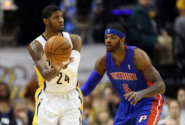 Dec 16, 2013; Indianapolis, IN, USA; Indiana Pacers forward Paul George (24) is guarded by Detroit Pistons forward Josh Smith (6) at Bankers Life Fieldhouse. Mandatory Credit: Brian Spurlock-USA TODAY Sports