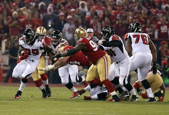 Dec 23, 2013; San Francisco, CA, USA; San Francisco 49ers outside linebacker Ahmad Brooks (55) tackles Atlanta Falcons running back Steven Jackson (39) during the first quarter of the final regular season game at Candlestick Park. Mandatory Credit: Kelley L Cox-USA TODAY Sports