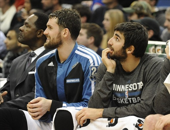 Dec 30, 2013; Minneapolis, MN, USA; Minnesota Timberwolves forward Kevin Love (L) and Minnesota Timberwolves guard Ricky Rubio (R) sit on the bench in the fourth quarter against the Dallas Mavericks at Target Center. The Mavericks won 100-98. Mandatory Credit: Marilyn Indahl-USA TODAY Sports