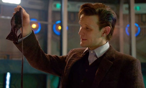 "The Eleventh Doctor pulls his bow tie from around his neck for the final time in the ""Doctor Who"" Christmas Special entitled ""The Time of the Doctor."" Photo Credit: BBC"