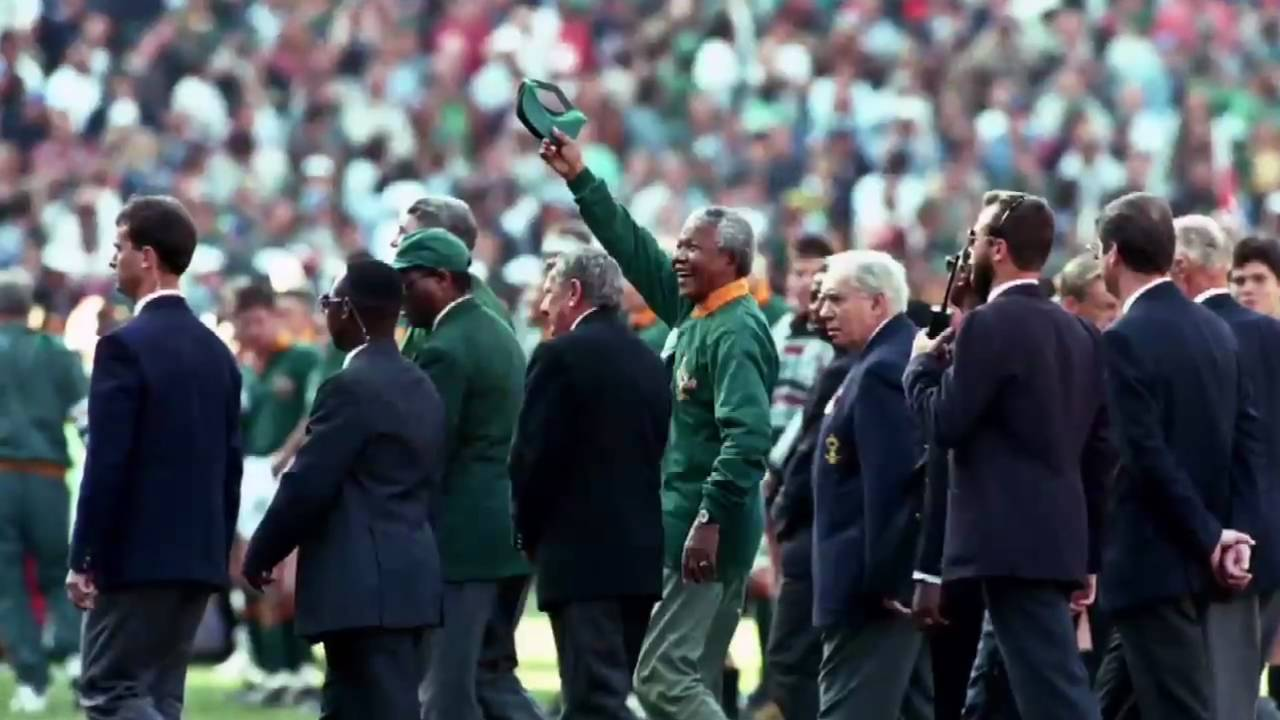 mandela and rugby He emerged into bright winter sunshine, stepped onto the lush field and pulled on a cap his long-sleeve green rugby jersey was untucked and buttoned right up to the top, a style all his own.