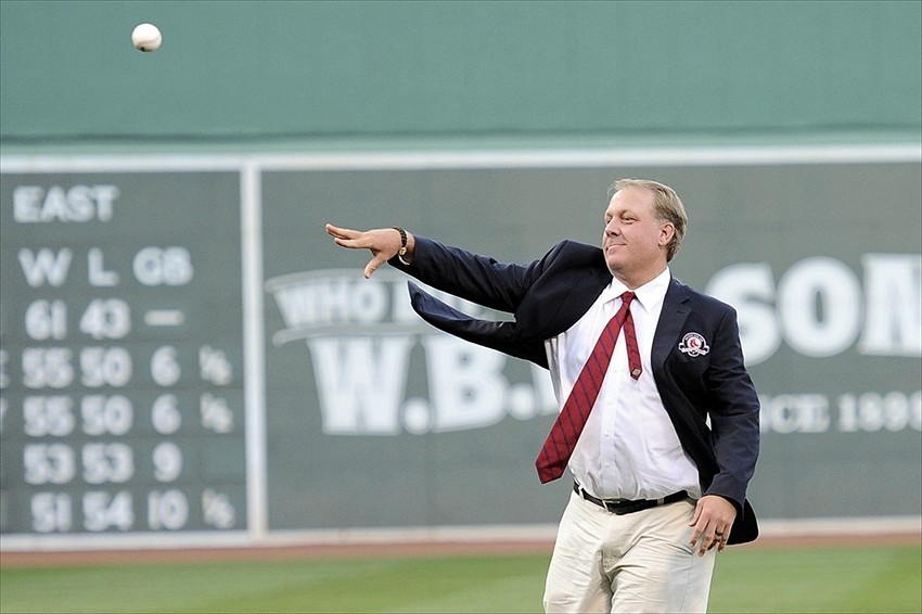 August 3, 2012; Boston, MA, USA; Boston Red Sox former pitcher Curt Schilling throws out a ceremonial first pitch prior to a game against the Minnesota Twins at Fenway Park. Mandatory Credit: Bob DeChiara-USA TODAY Sports