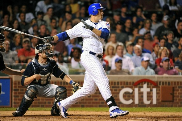 August 27, 2012; Chicago, IL, USA; Chicago Cubs first baseman Bryan LaHair (6) hits a double against the Milwaukee Brewers during the sixth inning at Wrigley Field. Mandatory Credit: Rob Grabowski-USA TODAY Sports