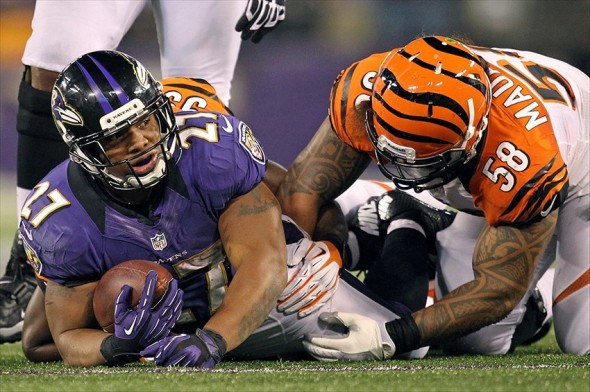 September 10, 2012; Baltimore, MD, USA; Baltimore Ravens running back Ray Rice (27) following a tackle by Cincinnati Bengals linebacker Ray Maualuga (58) at M