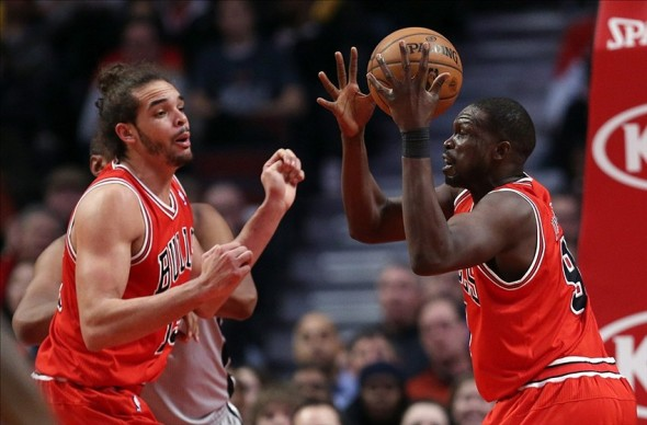 Feb 11, 2013; Chicago, IL, USA; Chicago Bulls center Joakim Noah (left) watches as small forward Luol Deng (9) pulls down a rebound against the San Antonio Spurs during the third quarter at the United Center. The Spurs won 103-89. Mandatory Credit: Jerry Lai-USA TODAY Sports