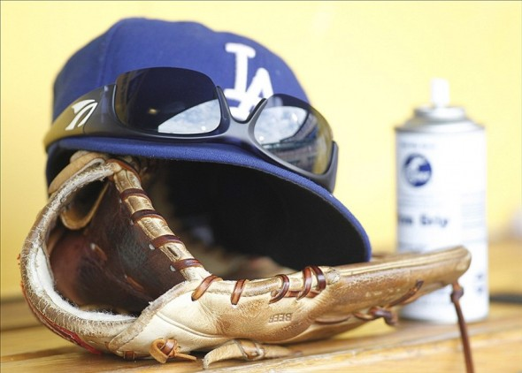 Jun 16, 2013; Pittsburgh, PA, USA; Los Angeles Dodgers hat glove and sunglasses in the dugout against the Pittsburgh Pirates during the fourth inning at PNC Park. The Pittsburgh Pirates won 6-3. Mandatory Credit: Charles LeClaire-USA TODAY Sports