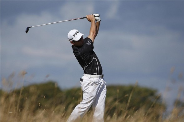 July 18, 2013; Gullane, United Kingdom; Louis Oosthuizen hits his tee shot at the 6th hole during the first round of the 2013 The Open Championship at Muirfield Golf Club. Mandatory Credit: Paul Cunningham-USA TODAY Sports