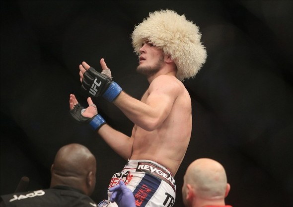 Sep 21, 2013; Toronto, Ontario, CAN; Khabib Nurmagomedov celebrates his victory over Pat Healy (not pictured) during their Lightweight bout at UFC 165 at the Air Canada Centre. Mandatory Credit: Tom Szczerbowski-USA TODAY Sports